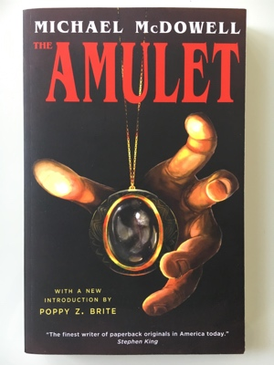 book review the amulet michael mcdowell